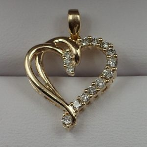 J-44 10kt Gold and Diamond Pendant $340.00